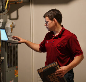 HVAC-Furnace-Technician-on-Computer