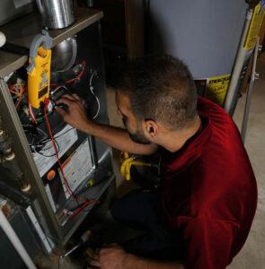 HVAC-Technician-Working-on-Furnace-Overhead